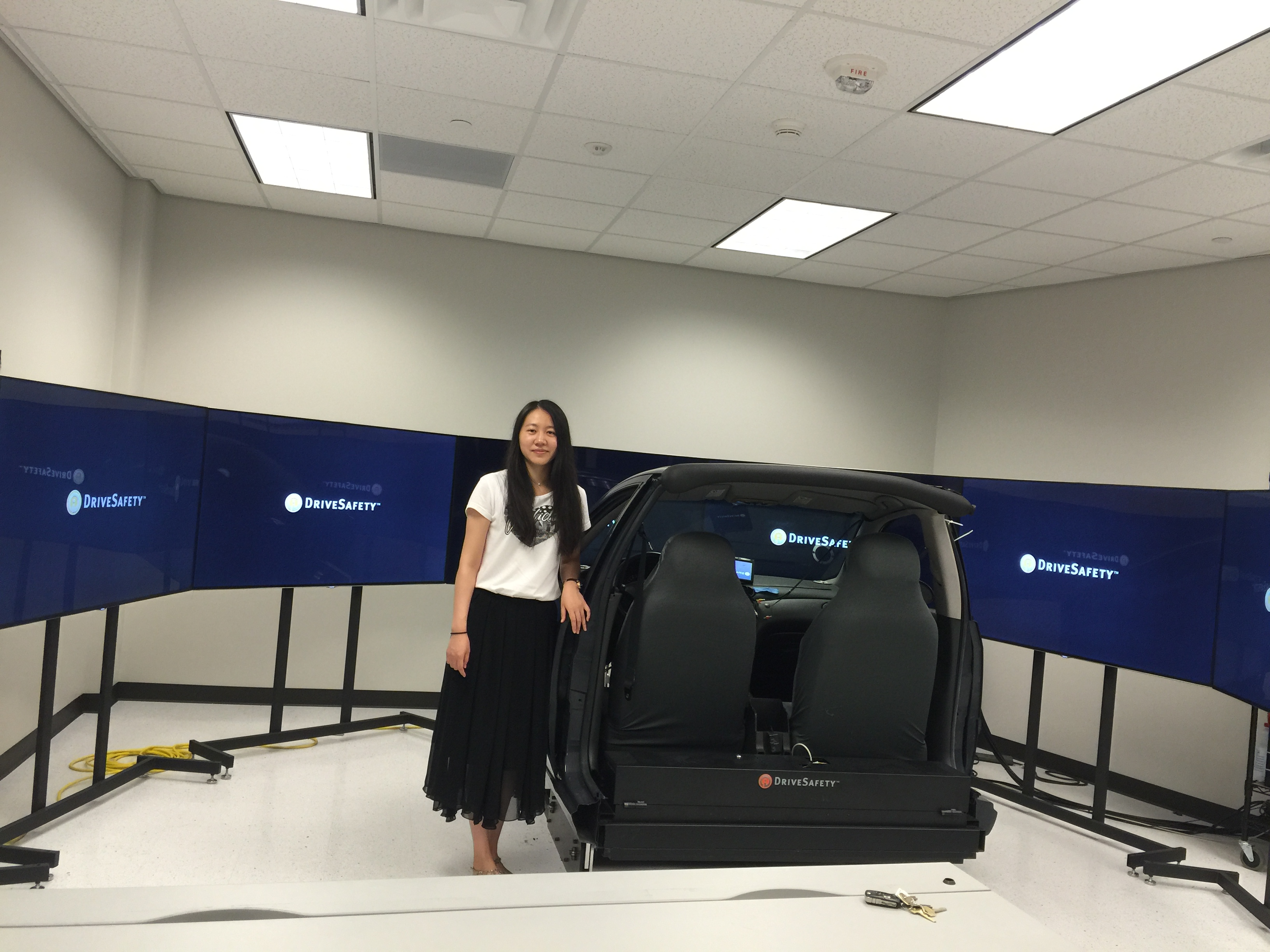 Ms. Sun in the driving simulator lab